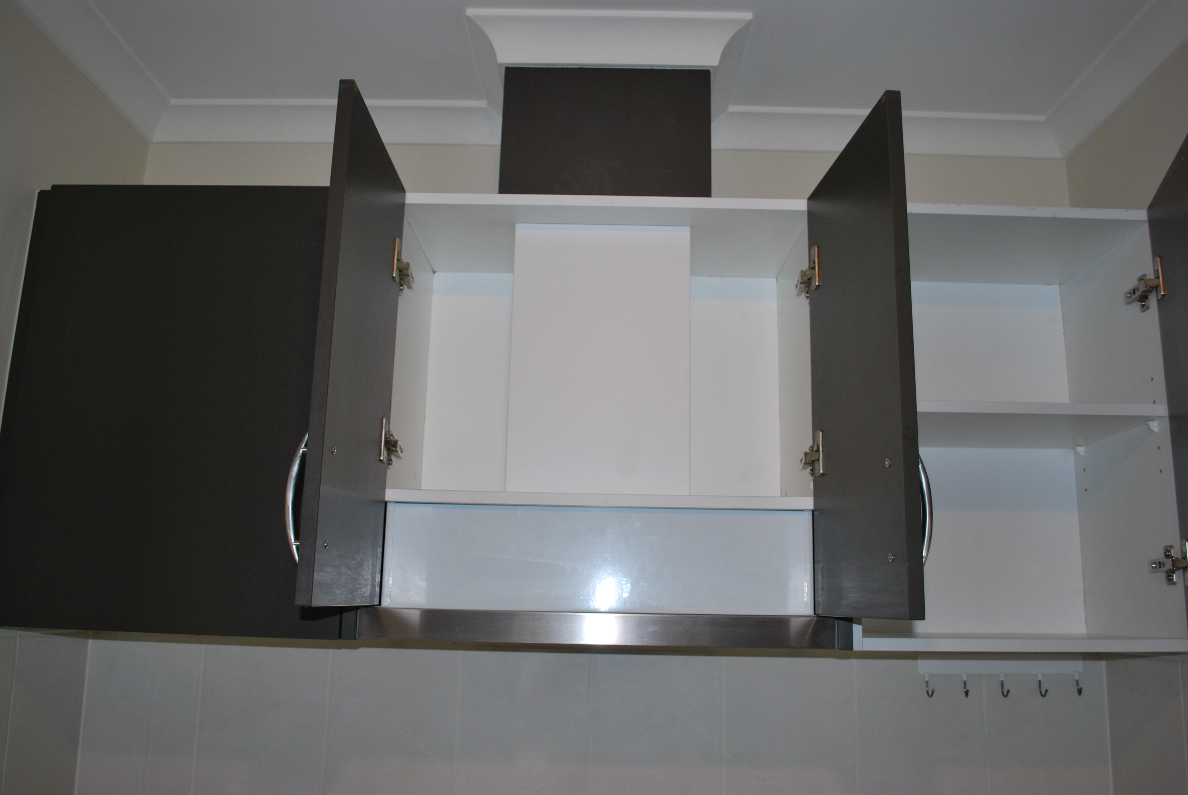 Install duct pipe to rangehood through the roof tiles 4