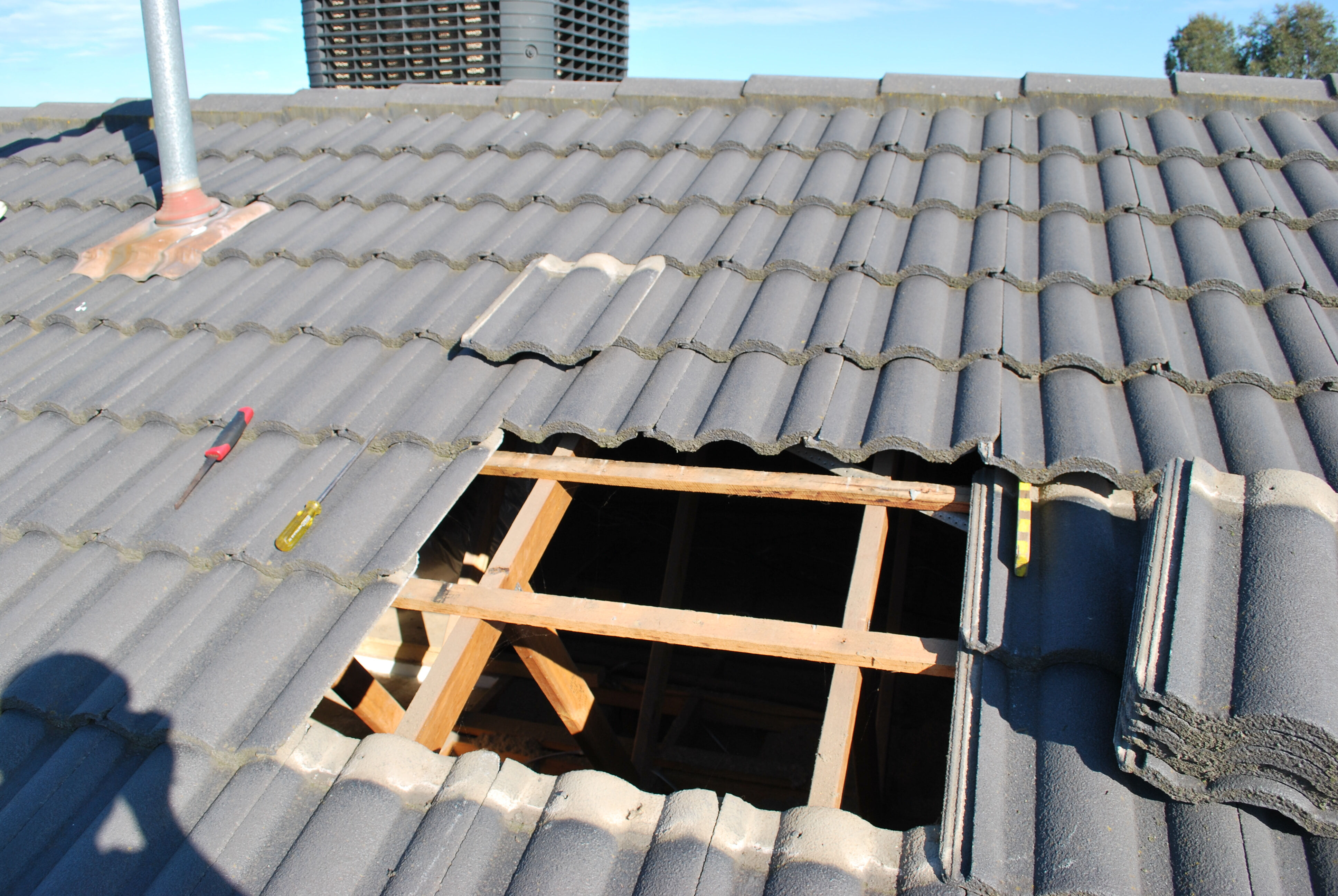 Install duct pipe to rangehood through the roof tiles 2