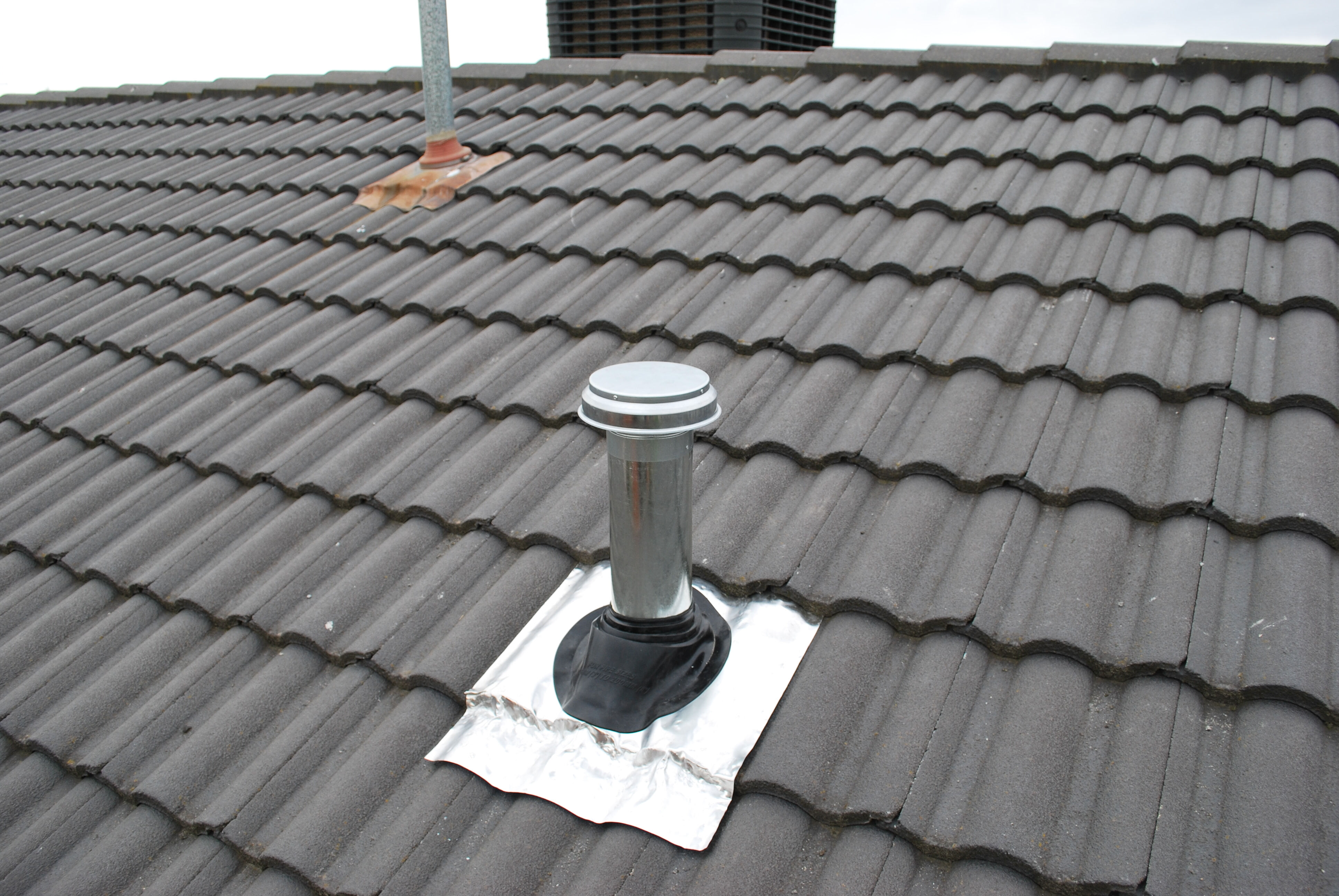 Install duct pipe to rangehood through the roof tiles 3